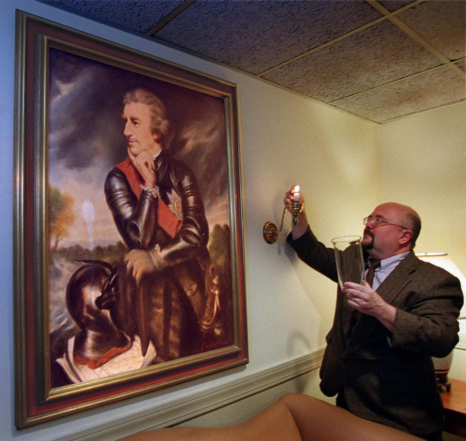 Michael Maderia, general manager of the Lord Jeffrey Inn in Amherst, lit a candle next to a painting of Lord Jeffrey Amherst.